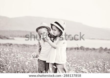 two little friends girls in the field - stock photo
