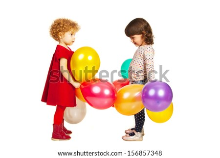 Two little friends girls playing with balloons isolated on white background - stock photo