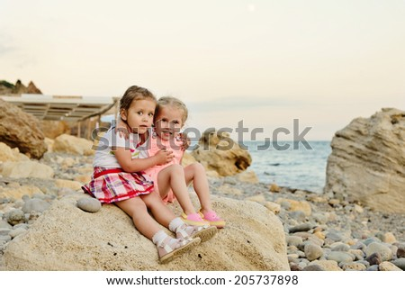 two little friends  on the sea shore - stock photo