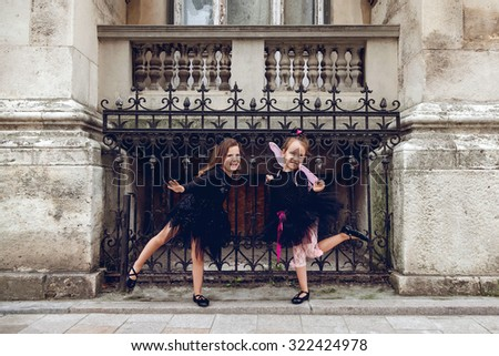 Two little girl dressed in Halloween costume - stock photo
