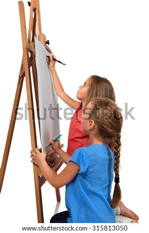 two little girl is painting on blank easel - stock photo