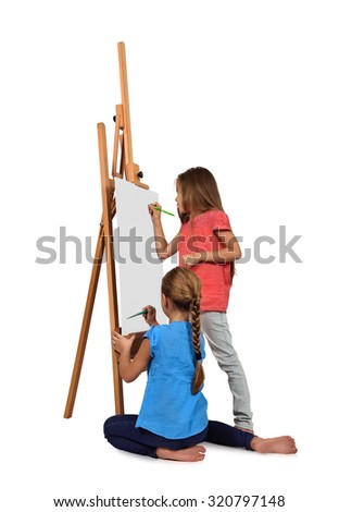two little girl painting on a blank easel - stock photo