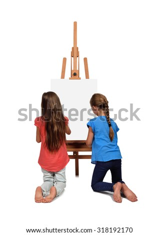 two little girl standing near a blank easel - stock photo