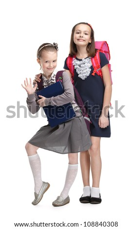 Two little girls are happy to start new year of study, isolated, white background - stock photo