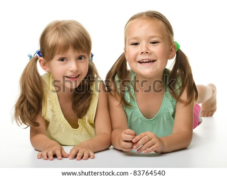 Two little girls - best friends, isolated over white