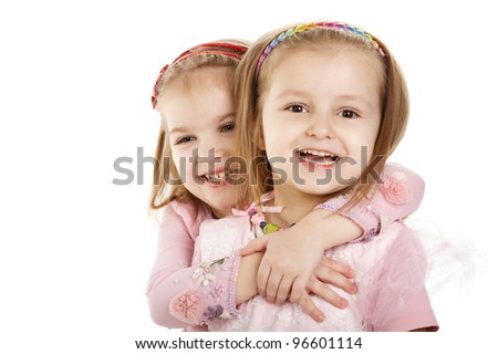 Two little girls - best friends, isolated over white - stock photo