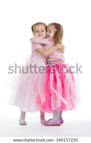 Two little girls - best friends on white background - stock photo
