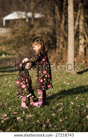 Two little girls dancing at the park - stock photo