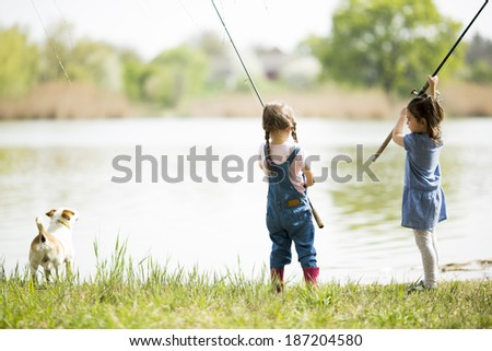 Two little girls fishing - stock photo