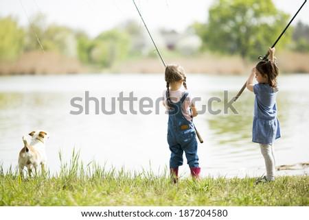 Two little girls fishing - stock photo