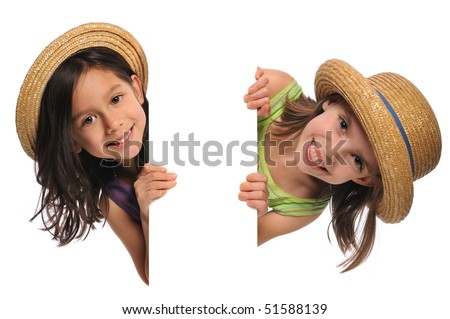 Two little girls holding a blank sign isolated on a white background
