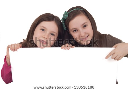 Two little girls holding a white banner isolated on white background