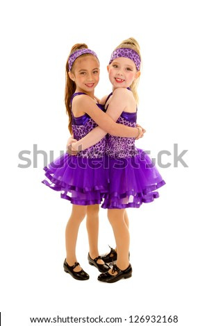 Two Little Girls Hugging in their Tap Dance Costume - stock photo
