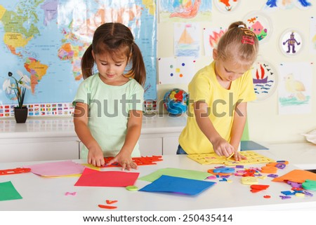 Two little girls in the classroom - stock photo