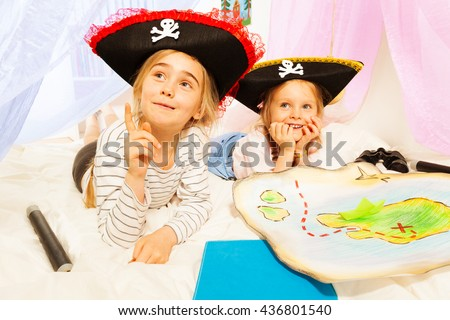 Two little girls playing pirates at imagine ship - stock photo