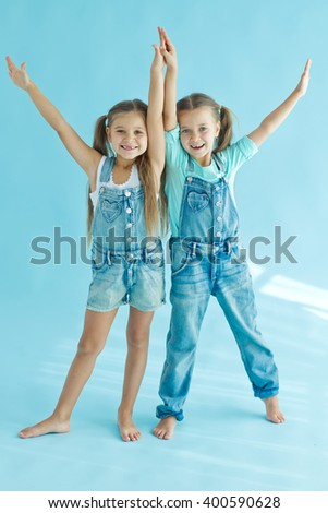 two little girls posing together - stock photo