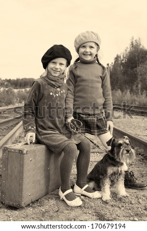 two little girls traveling with miniature schnauzer - stock photo