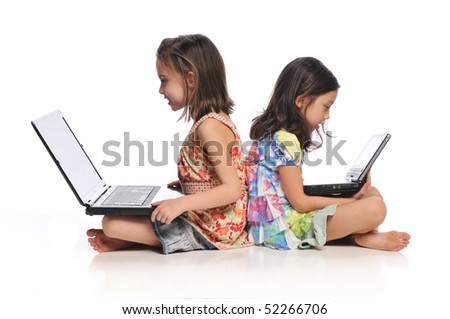 Two little girls with laptop computers isolated on a white background