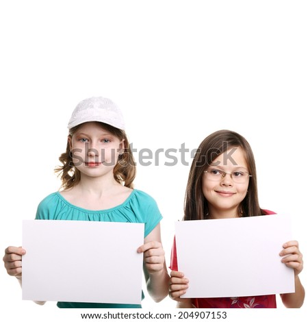 two little girls with the blank sheets of paper
