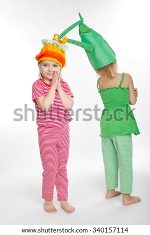 Two little girls with vegetation costumes on white