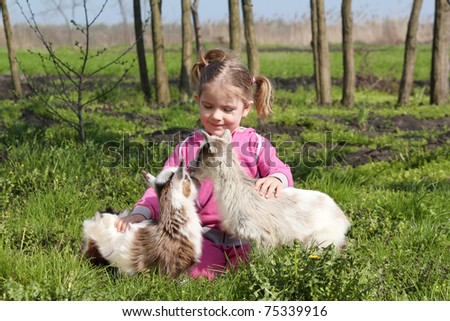 two little goats pets and child