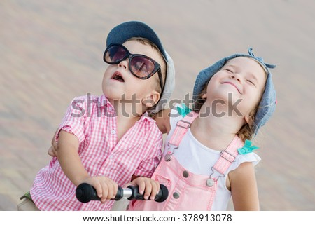 two little happy child play on a sunny day - stock photo