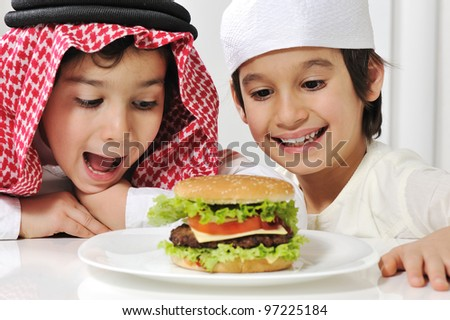 Two little kids with big Burger