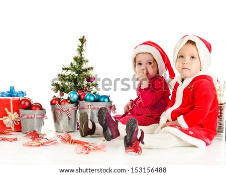 two little Santa girl in studio