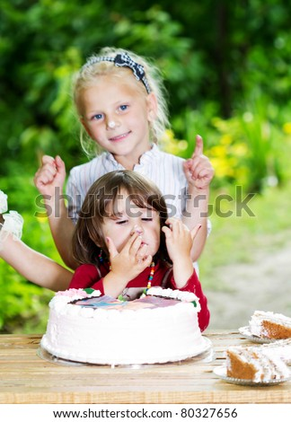 Two little sisters huging and celebrating birthday - stock photo