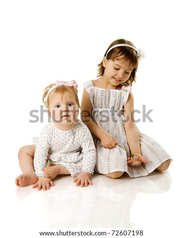 Two little Sisters playing together isolated on white