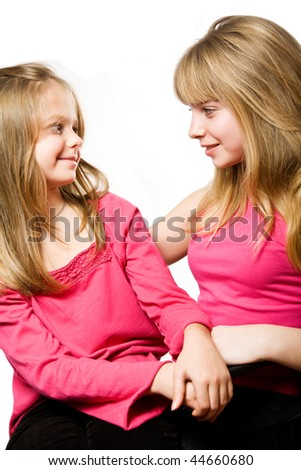 Two little sisters portrait isolated on white background