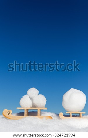 two little sledges with a lots of snowballs, concept greeting card for winter season - stock photo