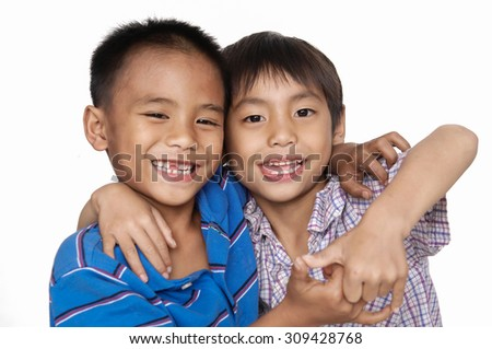 two little smile boy making funny face - stock photo