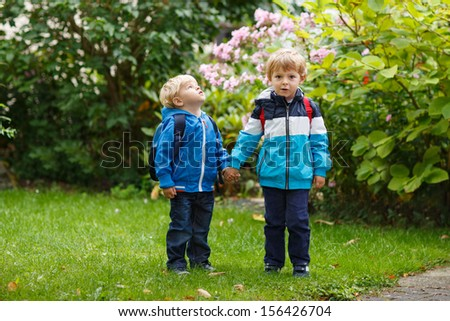 Two little toddler boys going to kindergarten