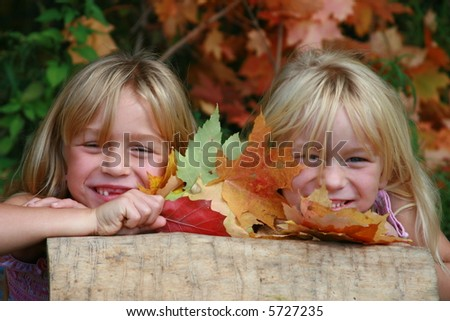 Two little twin girls having fall portraits taken.