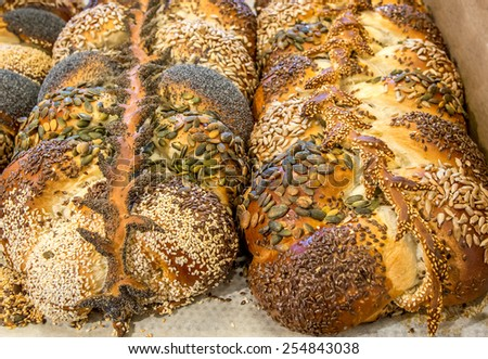 Two loaves of fresh Challah bread at the bakery  for Shabbat celebration. - stock photo