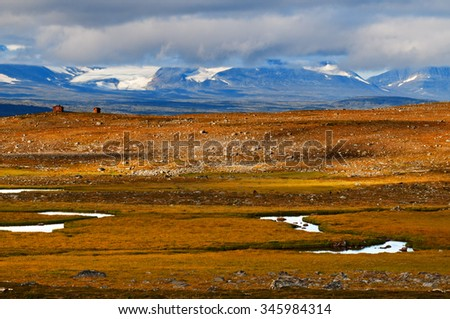 Two lonely hut in vast expanse of Swedish tundra.  - stock photo