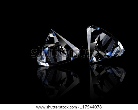 Two loose diamonds on black reflective surface - stock photo