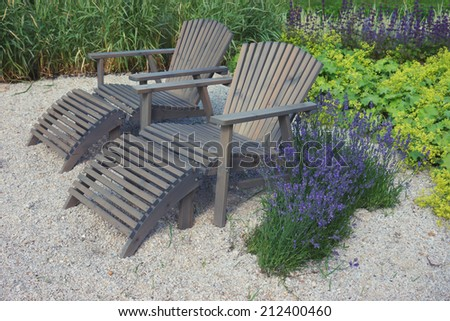 Two lounge chairs in a beautifully park