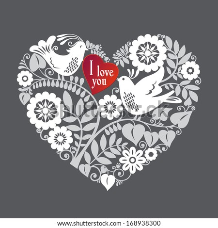 Two love birds are part of a beautiful floral lace like ornament that creates a heart shape design element. Love concept. - stock photo