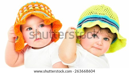 Two lovely kids in hats, isolated. summer time - stock photo