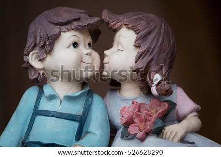 two lover dolls, girl kissing boy