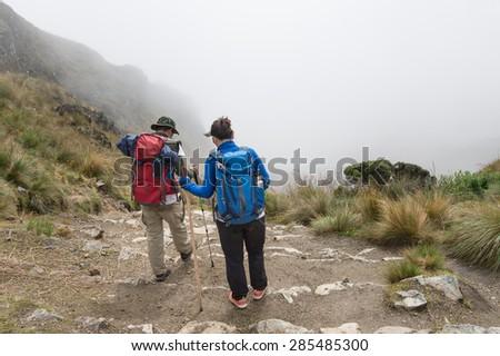 Two Lover walking on The Inca Trail, Machu Picchu, Peru - stock photo
