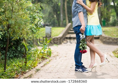 Two lovers embracing in the street - stock photo