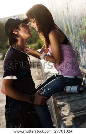 Two lovers kissing in a urban setting - stock photo