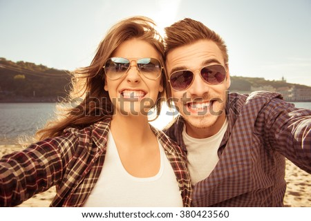 Two lovers making funny selfie - stock photo