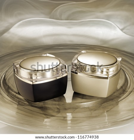 Two luxury cream containers on glamorous background - stock photo