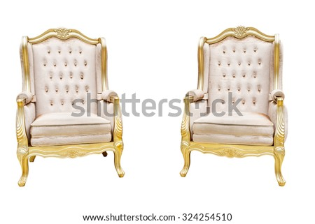 two luxury leathered chairs with golden decorated edge
