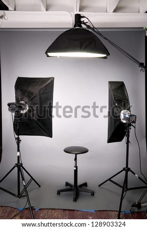 Two main lights a hair light posing stool on grey seamless in the photography studio - stock photo