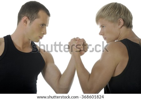 Two male arm-wrestlers trying to defeat each other on isolated white background. - stock photo